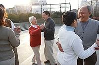 Senior couples dancing outdoors