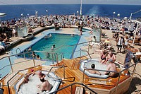 Lido Deck, Aft Pool, sauna, sunbathing. Holland America Line, MS Noordam. New York. USA.