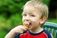 CHILD EATING SWEETS<BR>Model.