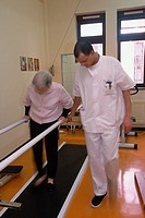 REHABILITATION, ELDERLY PERSON<BR>Photo essay from hospital. Physical therapist and patient.<BR>Swiss Hospital in Paris, France.