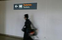ENURESIS<BR>Airport restroom.