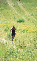 A woman running on the grass