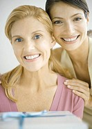Two women smiling with gift