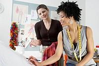Two female fashion designers