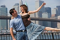 Couple Playing Near City Skyline