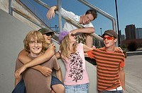 Friends hanging out at skate park