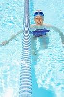 Woman treading water in swimming pool