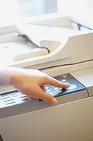 Woman making photocopies
