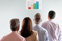 Business People Reading a Bar Graph