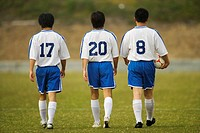 Soccer Players Walking Onto the Field