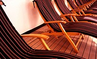 row of deck chairs on cruise ship