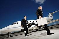 Two Businessmen Alighting From Private Jet