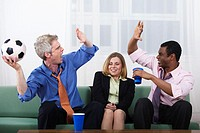 Professional Men High Fiving with Timid Coworker in Between