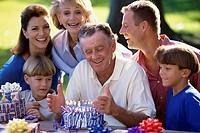 Close-up of a three generation family celebrating a birthday