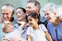 Close-up of a brother and sister with their parents and grandparents