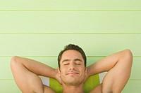 Man Relaxing in Deck Chair