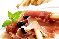 Grissini with parma ham and olives