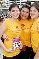 Corporate Fitness Run, participants, Hispanic mother, teen daughters. Bayfront Park. Miami. Florida. USA.