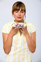 Young woman holding tea bowl
