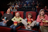 Family Enjoying a Movie at the Theater