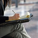 Woman Writing on Notepad