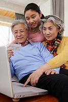 Granddaughter and Grandparents Shopping on the Internet