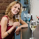 Young Woman Toasting with a Glass of Beer