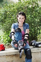 Young Woman Putting on Inline Skates