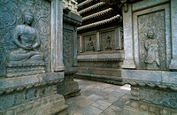 Close-up of statues of Buddha engraved on columns, China