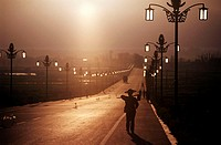 Rear view of a person walking on the road, China