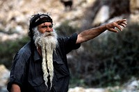 Close-up of a senior man pointing forward