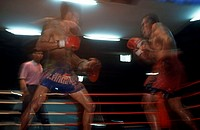 Two boxers boxing in a ring, Thailand