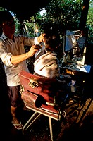 Boy getting a haircut from a hairdresser, Vietnam