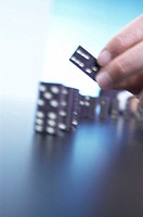 Men´s hand, dominos, positions, consecutively, fuzziness,   Man, hand, domino, game stones, domino game, Legespiel, game, row, symbol, chain reaction,...
