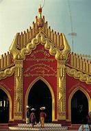 Women entering temple, Mandalay, Myanmar
