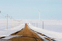 Wind Turbines on snowy prairie, with service road. Manitoba, Canada