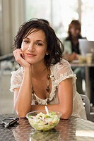 Young Businesswoman Eating Salad at Cafe