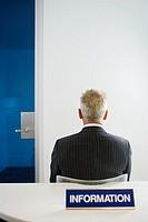 Man at Information Desk