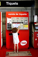 5 year old girl in front of ticket vending machine, Barcelona. Catalonia, Spain