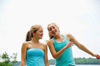 sisters 18 and 13 yrs laughing and playing at cottage