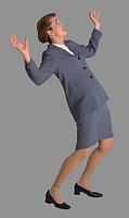 Businesswoman Leaning Back in Fear