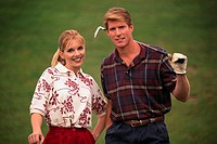 Smiling Golf Couple