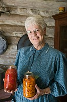 Woman with Canned Vegetables. Living History Farm at the LBJ Ranch. Johnson City. Hill Country. Texas, USA.