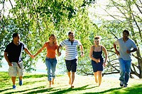group of young adults running together