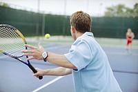 Man Returning Tennis Ball