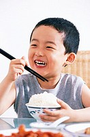 Boy Eating Rice from Bowl