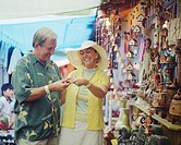 Couple Shopping for Handicraft at Market
