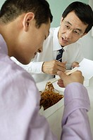 Businessmen having Chinese take-out lunch