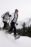 couple, snowshoes, sticks, snow,  running  Series, 20-30 years, winters, winter landscape, snow landscape, vacation, leisure time, hobby, winter vacat...