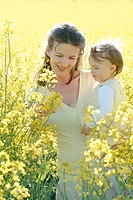 Mother, daughter, walk, carries,  Rapeseed field, portrait,  Series, woman, young, 20-30 years, leisurewear, parent, mother luck, happily, child, todd...